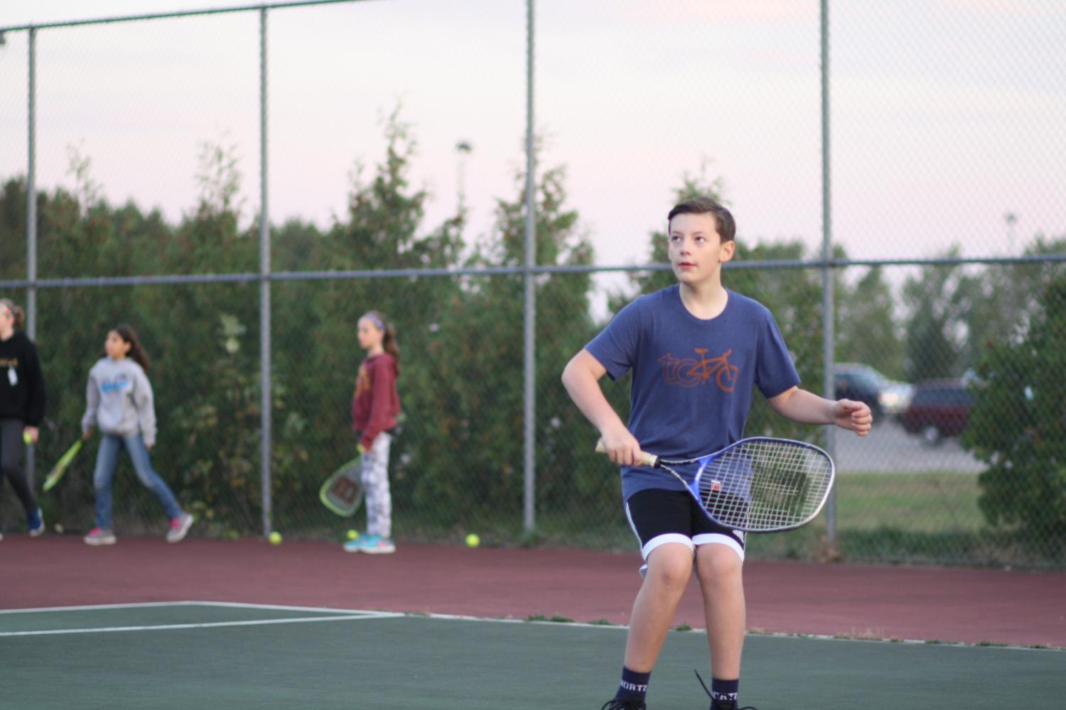 William+Unger+playing+tennis+in+gym.