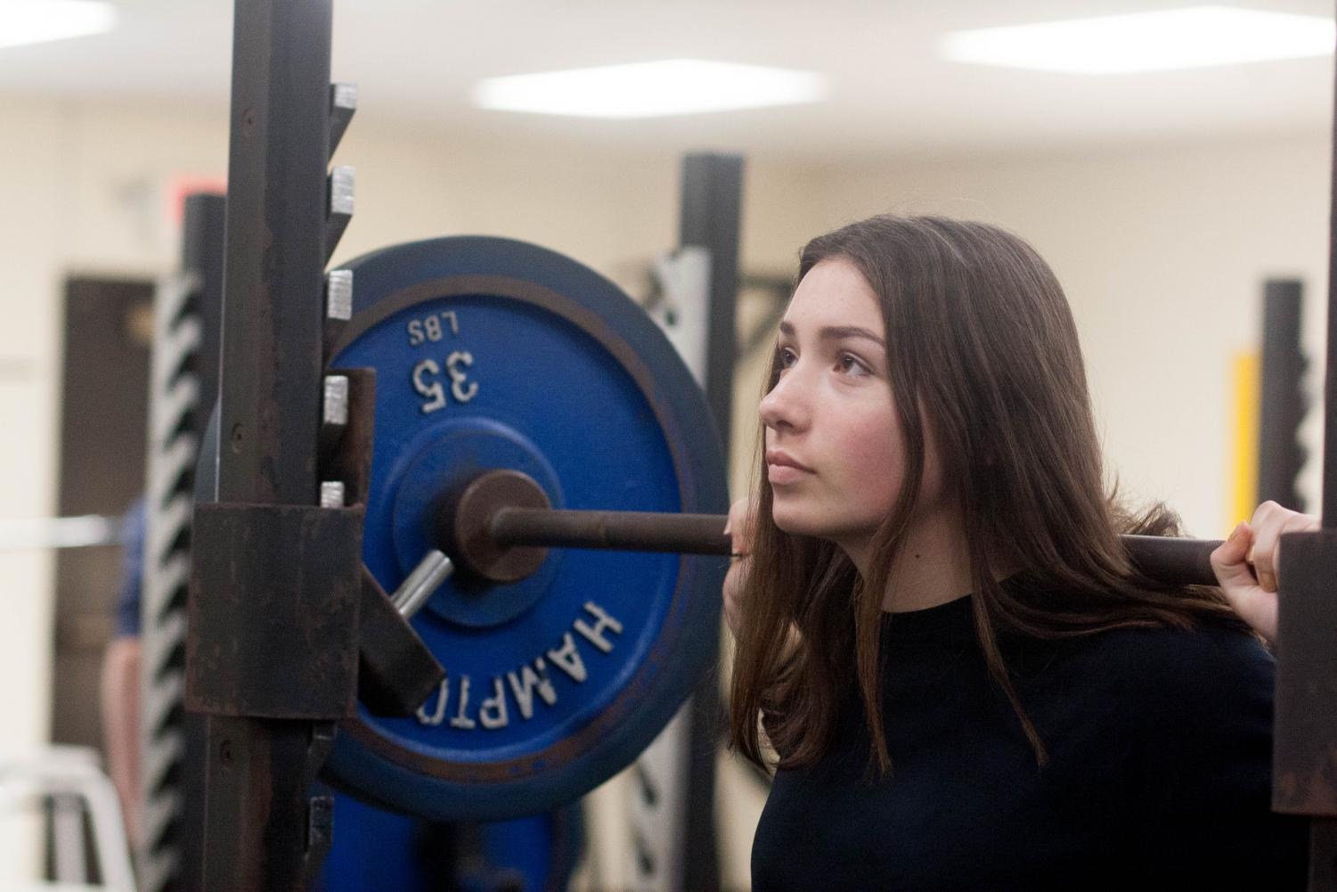 Alice Blanchard lifts weights in Weights and Conditioning class. Photo by Yearbook student, Ashley Piper.