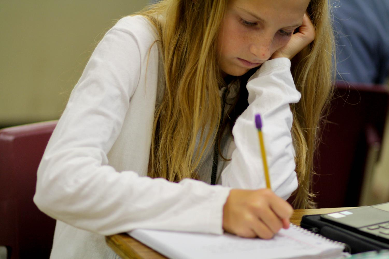 Katie Venhuizen writes a story in ELA. Photo by Yearbook student, Kate Mccrary.