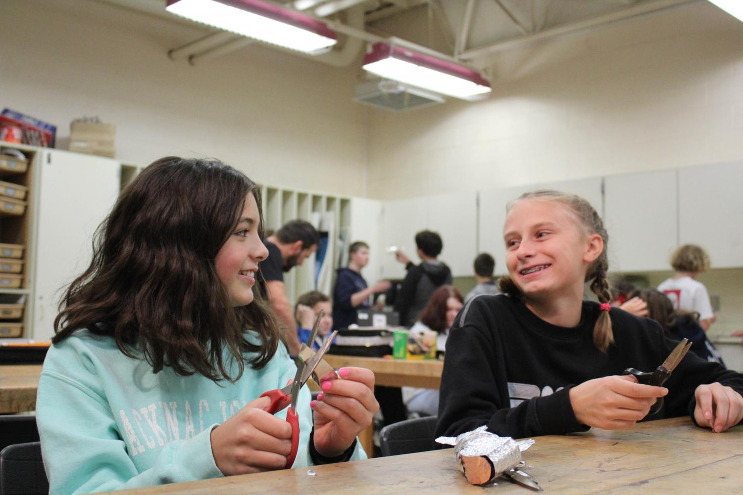 Roxy McClellan and Hayden Boonstra both (25) talk while making pottery.