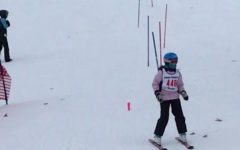 10 year old Houghton skis down the hill after finishing her first ski race.