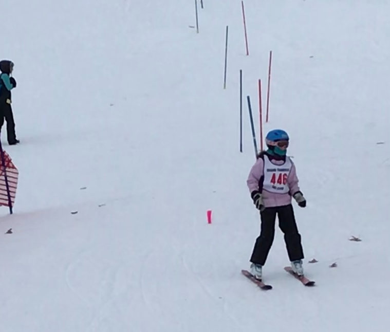 10+year+old+Houghton+skis+down+the+hill+after+finishing+her+first+ski+race.+
