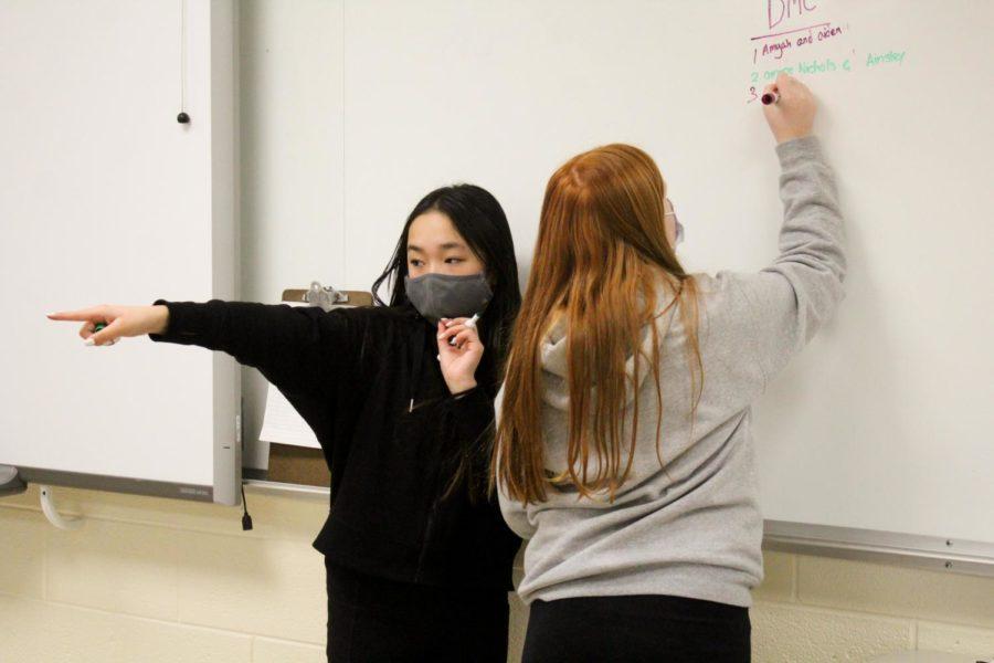 6th grade student council members, Sophia Phan and  Jade Krumlauf, write down ideas for school spirit day.